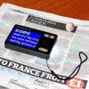 HandyReader HD video magnifier over a newspaper