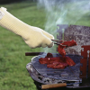 person using the gloves while cooking