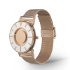 Side angle of stylish tactile watch with silver-coloured and rose gold-coloured features