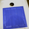 Close up of non-slip bath mat in a bath