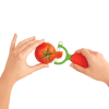person using the peeler to peel a tomato