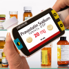 Medicine bottles with coloured text on the Pebble HD 4.3 Inch magnifier