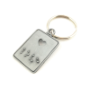 Keyring straight on with a punched heart-shaped hole and the word 'love' brailled underneath