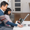 Man and woman using Compact 10 HD Video Magnifier