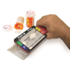 Ruby handheld video magnifier being used to look at medication
