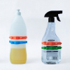 Two household cleaning product bottles each with 2 Band-Its on them