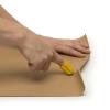Someone using a nimble cutter on cardboard