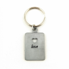Keyring at a straight-on with a punched heart-shaped hole and the word 'love' engraved underneath
