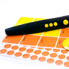 RNIB PenFriend 3 with orange and yellow labels