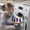Woman putting clothes in machine