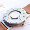 Angled Bradley tactile watch with stainless steel face has a brown leather strap
