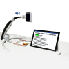 An upright Transformer HD portable magnifier camera solution next to a tablet
