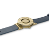 Top  view of a of a stylish tactile watch with gold-coloured features and a navy blue leather strap