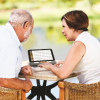 A man and a woman using the HD touchscreen magnifier