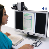 A woman looking at image from book on the screen of a DaVinci Pro HD Desktop Video Magnifier
