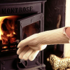 Close-up of a person using the gloves and an oven