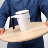 A white anti-spill suction cup on tray