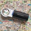 Eschenbach hand magnifier on top of a map