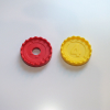 close up of yellow and modified red discs