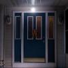 The sensor light affixed above a door