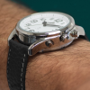 Side view of Peregrine talking watch with black strap and white face on a wrist, showing the crown