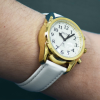 Angled view of buttons on Robin takjing watch with white strap on wrist