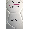 Close-up of Dave Clarke's signature and RNIB logo on the Rainbow blind football.