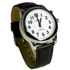 Angled view of the white faced watch with clear black numbers and hands and black leather strap