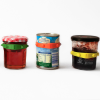 A row of three tins and jars with Band-Its on
