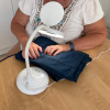 Lamp being used as a sewing aid