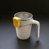 A white anti-spill suction mug with a Liquid Level Indicator