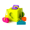 A bright sensory shape sorter with four textured, tethered shapes in view