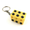 Braille cube keyring on its side