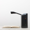 Side view of an Optelec ClearReader+ Portable ImageReader with arm extended with a book underneath