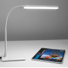 Lamp switched on arm at a 90-degree angle with a book underneath