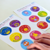 Two sheets of sport-themed tactile stickers