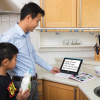 Father and son using the Compact HD to look at a recipe in the kitchen