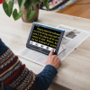 Compact 10 HD Video Magnifier reading a newspaper